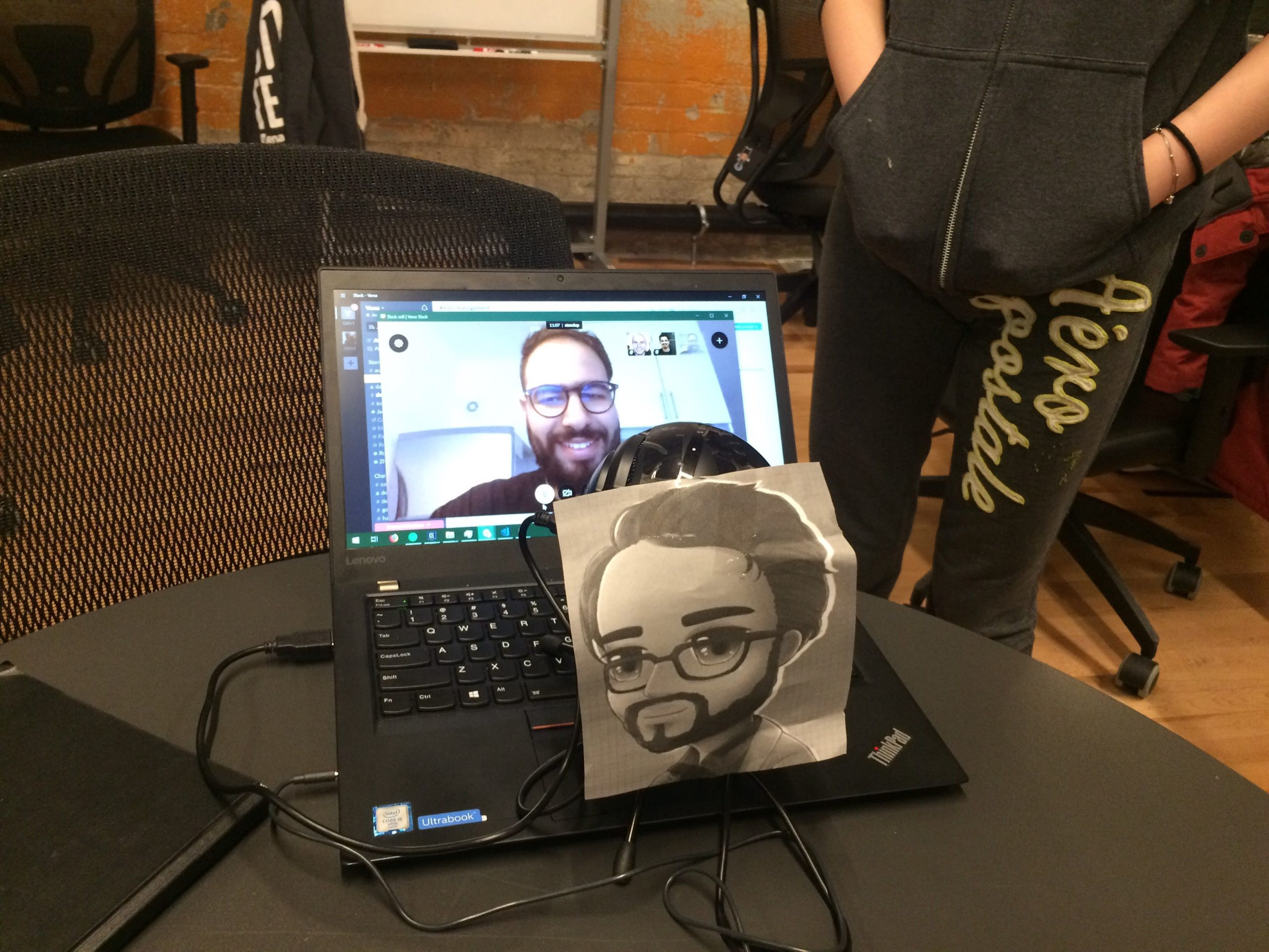 Mustafa doing a stand-up meeting remotely