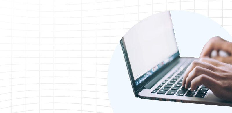 Sideview of a laptop over a grid background.